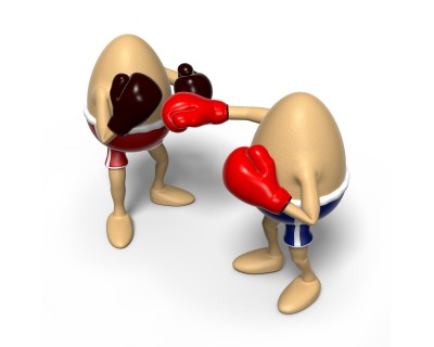 Two Eggs with boxing gloves fighting