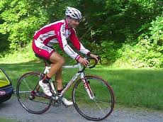 Bicyclist in full cycling apparel.