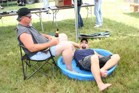 Two men in wading pool