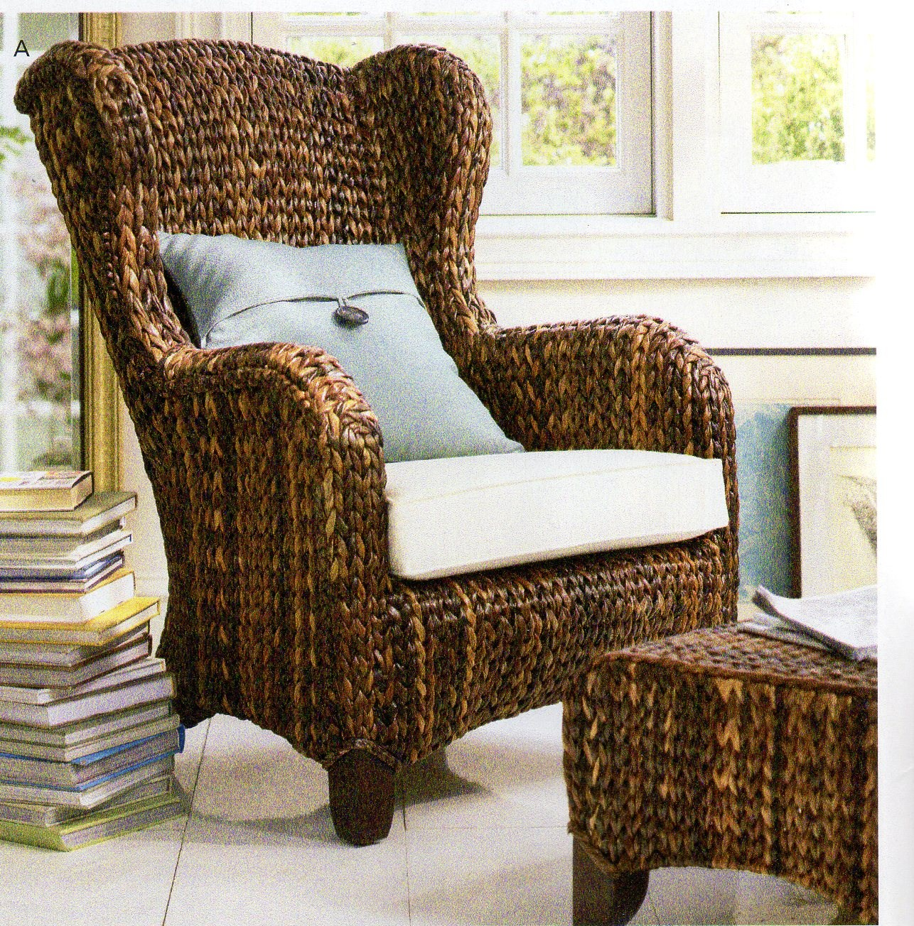 This is NOT your ordinary wicker chair. It's a Pottery Barn chair ...