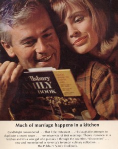 a couple looked at a Pillsbury cookbook