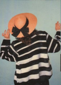 A woman in a striped black and white sweater