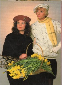 women posing in sweaters and hats